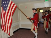 A fife and drum corps greets meeting participants at the opening session