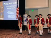 The fife and drum corps stands at attention to open the didactic sessions