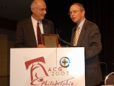 Dr. David Johnson, Immediate Past-President of the ACG, presents Dr. Banks with the Emily Couric Lecture plaque