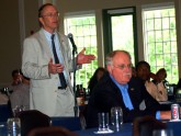 Dr. David Johnson, Eastern Virginia Medical School and Past President of the ACG, asks a question during a panel discussion. Dr. David Peura, University of Virginia and Past President of the AGA, is in the foreground.