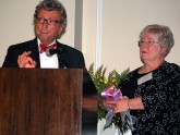 Dr. Alvin Zfass presents the ODSGNA Service Award to Gail DeCosta, RN